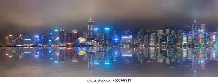 Hong Kong foggy night on Victoria's harbour from Tsim Sha Tsui waterfront