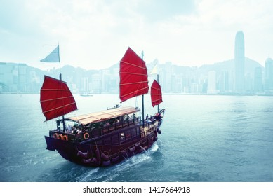 Hong Kong harbour and traditional vessel, China