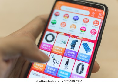 Hong Kong, Hongkong - November 11, 2018: Man holding Samsung S9 with Taobao app on screen, a Chinese online shopping is a subsidiary of Alibaba Group one of the world's biggest e-commerce web.