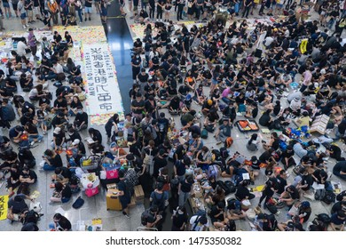 Hong Kong International Airport - 10 August, 2019: Hong Kong Anti-extradition bill protest in the airport. Protesters used handmade banner and leaflet to explain extradition bill to the tourists.