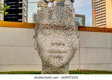 Hong Kong Island, Hong Kong - January 3, 2020: A sculpture by the artist Jaume Plensa 'Awilda's White Head' on display on the terrace of the Murray Hotel in Hong Kong