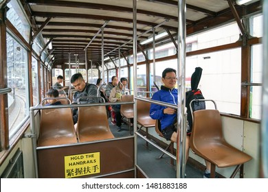 Hong Kong island, Hong Kong-14th March 2019: The interior of Hong Kong tram with communters as it passed through an older part of the city.