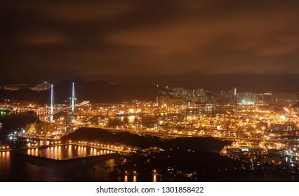 Hong Kong - Jan 18: Kwai Tsing Container Terminals is the main port facilities in the reclamation along Rambler Channel between Kwai Chung and Tsing Yi Island, Hong Kong on January 18 2015.