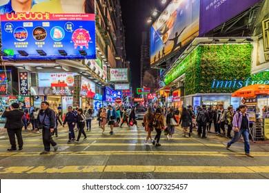 HONG KONG - JAN 18 : Neon lights on Mong Kok shopping street on January, 18, 2018. Mong Kok Shopping street is a very popular shopping place in Hong Kong.