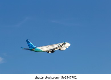 HONG KONG - JAN 23, 2017: Garuda Indonesia airplane departing from the Hong Kong International Airport. Garuda Indonesia is the national airline of Indonesia.