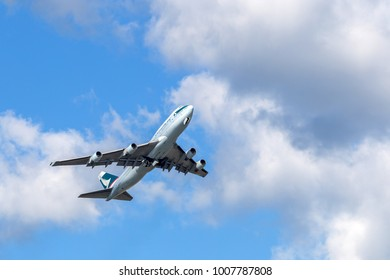 HONG KONG - JAN 23, 2018: Cathay Pacific airplane departing from the Hong Kong International Airport. About 90 airlines operate flights from HKIA to over 150 cities across the globe.