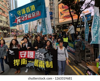 HONG KONG - JANUARY 1, 2018: Martin Lee, the iconic democracy fighter in Hong Kong, marching on the street with his fellow party members. Editorial Use Only.