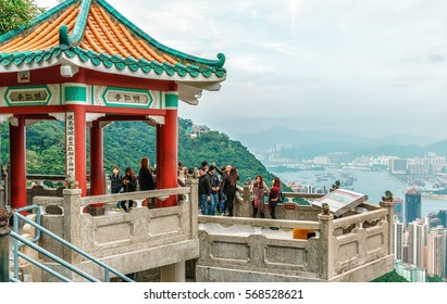 Hong Kong - January 12, 2016: Observation deck with ornate pagoda on Victoria Peak in Hong Kong is visited by millions of people a year to enjoy beautiful scenery of Victoria Harbor city skyline