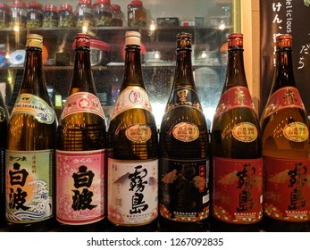 HONG KONG - JANUARY 12, 2018: Beautiful and tidily placed bottles of Sake in a Japanese restaurant in Hong Kong. Editorial Use Only.