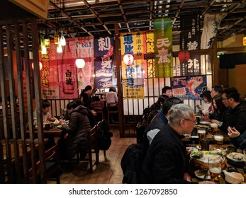 HONG KONG - JANUARY 12, 2018: Customer enjoying their meal at a traditionally decorated Japanese Restaurant in Hong Kong. Editorial Use Only.
