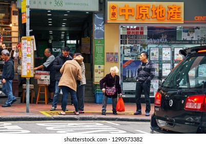 HONG KONG - JANUARY 2, 2019:  Woman with a cane on the sidewalk in a big city