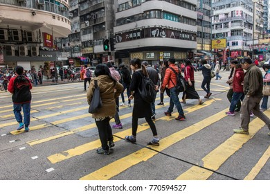 Hong Kong, January 2017. People walk in Mongkok district