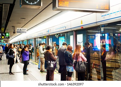HONG KONG - JANUARY 21: Unidentified people waiting for a subway train on January 21, 2013 in Hong Kong. MTR had 46.4% of the public transport market, making it the most popular transport in Hong Kong