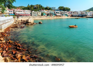 Hong Kong - January 25, 2016: Yung Shue Wan village on Lamma Island is a mix of residential properties, shops and restaurants which front onto the small bay commonly filled with fishing boats at rest