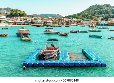 Hong Kong - January 25, 2016: The small bay of Yung Shue Wan village on Lamma Island is filled with boats of fisherfolks who support local waterfront restaurants with fresh seafood