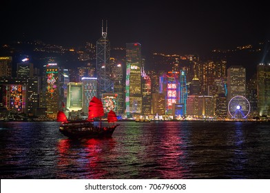 HONG KONG - JANUARY 25, 2016: The Aqua Luna sail around Victoria Harbour in the night. The Aqua Luna is a Chinese Junk operating in Victoria Harbour, Hong Kong