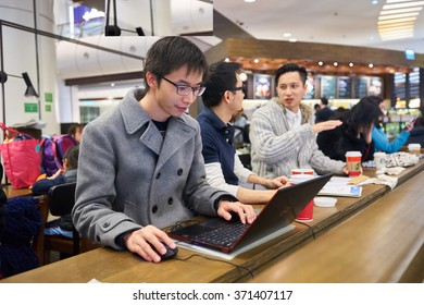 HONG KONG - JANUARY 27, 2016: man use laptop at Starbucks cafe. Starbucks Corporation is an American global coffee company and coffeehouse chain based in Seattle, Washington