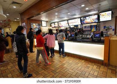 HONG KONG - JANUARY 27, 2016: interior of McDonald's restaurant. McDonald's primarily sells hamburgers, cheeseburgers, chicken, french fries, breakfast items, soft drinks, milkshakes, and desserts