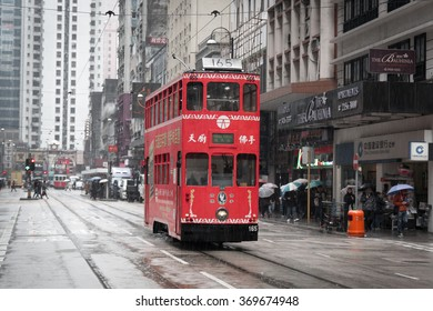 HONG KONG - January 28, 2016: Hong Kong cityscape view with double-deck electric tram moving on the rainy street