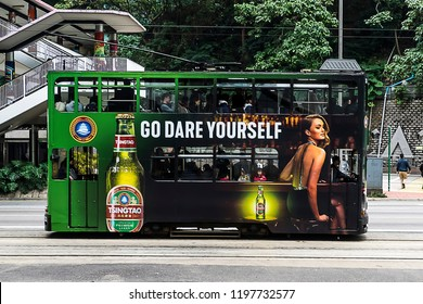 Hong Kong - January 28, 2018. Hong Kong tram advertising Tsingtao beer.