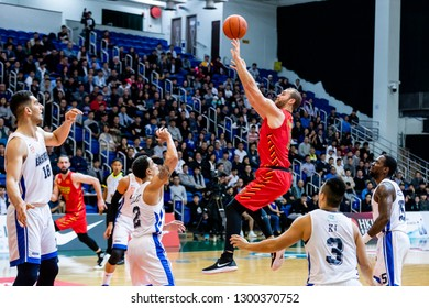 Hong Kong - January 30 2019: #13 Murphy Burnatowski of Saigon Heat shoots the ball during the ASEAN Basketball League match between Hong Kong Eastern and Saigon Heat at Southorn Stadium, Hong Kong