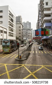 Hong Kong, Hong Kong - January 8, 2012: Modern Skyscrapers and transport on the road in Kowloon in Hong Kong. People on the background