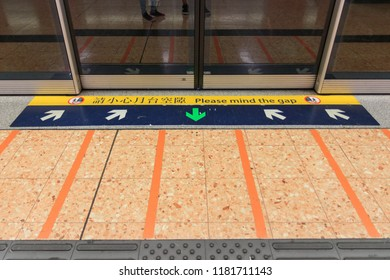Hong Kong - July 02, 2018: Please Mind The Gap Sign In Front Of The MTR Door