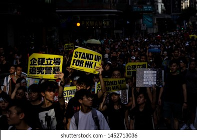 """HONG KONG - JULY 1 2019: Hong Kong people holding signage/poster of """"Stand Up For HK"""" to appeal to during a protest against the Extradition Bills on the 22nd Handover Anniversary Day."""