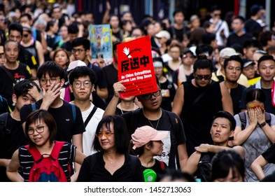 HONG KONG - JULY 1 2019: half million Hong Kong people took to the street, dressed in black, protesting against the Extradition Bills on the 22nd Handover Anniversary Day.
