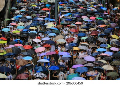 HONG KONG, JULY 1: People use umbrella on the street in rainly day in hong kong on 1 july 2014. July is the summer weather in hong kong with the high rainfall