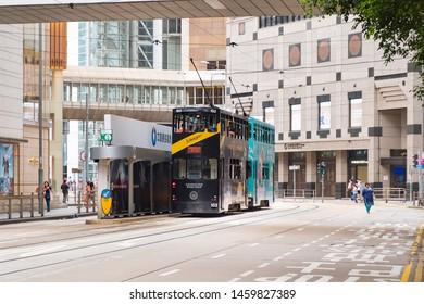 Hong Kong - July 14, 2019 : Double-decker tramway parking at station for waiting passengers.