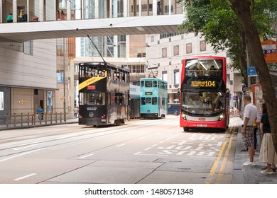 Hong Kong - July 14, 2019 : Double-decker tramway and double-decker bus running on Hong Kong island road. Hong Kong transportation. Hong kong island.