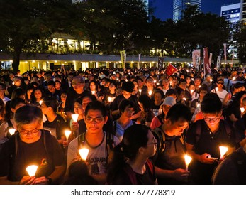 HONG KONG - JULY 15, 2017: Thousands of Hong Kong people showed up in a Candlelight March mourning late Chinese dissident Liu Xiaobo, and demanding the release of his wife Liu Xia. Editorial Use Only.