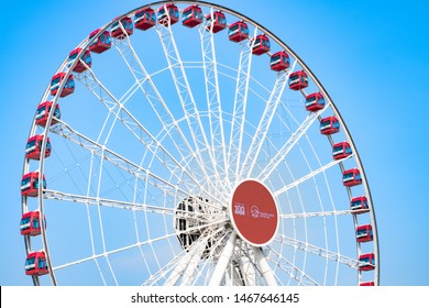 Hong Kong - July 16, 2019 : Hong Kong Observation Wheel, the iconic Central Harbourfront in Hong Kong, with AIA company logo.