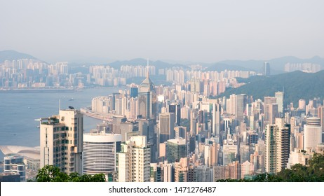 Hong Kong - July 16, 2019 : Modern buildings around Victoria Harbor as viewed atop Victoria Peak with foggy. City skyline. Island business district.