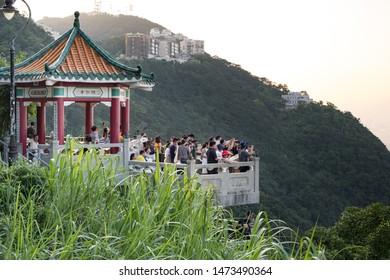 Hong Kong - July 16, 2019 : Tourists sightseeing and taking photos at Victoria Peak in Hong Kong.