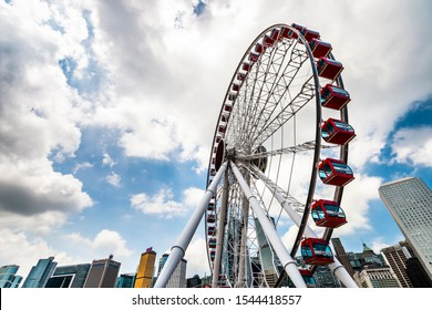 Hong Kong -July 16, 2019: Ferris wheel and skyscraper in Hong Kong.