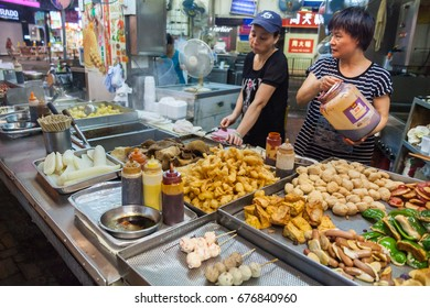 HONG KONG - JULY 17, 2014:  Hong Kong Street Food. The Stalls and Fresh Markets of Mong Kok
