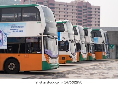 Hong Kong - July 17, 2019 : Double dacker buses by New World First Bus Services Limited company, franchised bus service in Hong Kong Island, parking at depot.