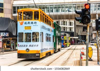 Hong Kong -July 17, 2019: Famous double-decker trams on the street of Hong Kong Island