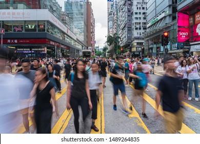HONG KONG, HONG KONG - JULY 2019 : Crowd Unrecognizable Protester walking around Tsim Sha Tsui street area on July 7, 2019, Hong Kong, The fugitive law amendment sparks more thatn 1 million people
