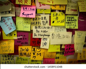 """Hong Kong - July 23 2019 : Lennon wall at Tsim Sha Tsui MTR. People write post-it memos to show their opinions on Anti-Extradition Bill Protest. The centre memo writes """"Be Water, be Hongkongers"""""""