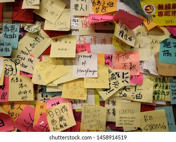 """Hong Kong - July 23 2019 : Lennon wall at Tsim Sha Tsui station. People write post-it memos to show their opinions on Anti-Extradition Bill Protest. The centre memo writes """"Proud of Hongkonger"""""""