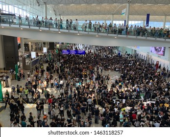 Hong Kong - July 26,2019: Many Hong Kong protesters at the Hong Kong international airport arrival hall are protesting the goverment againtst the controversial extradition bill.