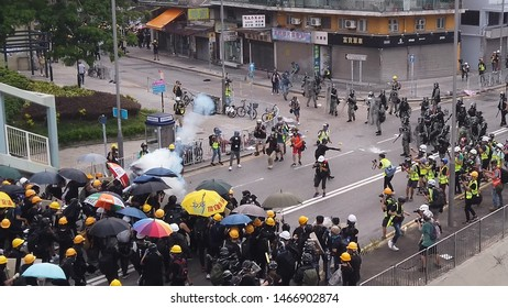 HONG KONG - JULY 27 2019: Tear gas hit an umbrella when thrown to protesters during a clash between police and protesters in Hong Kong