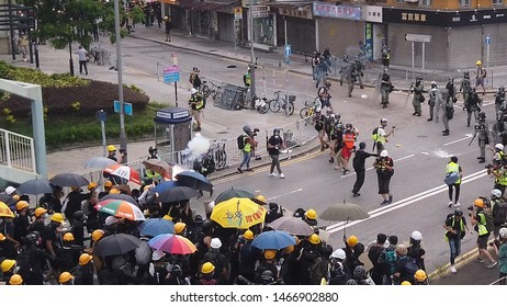 HONG KONG - JULY 27 2019: The moment of impact - Tear gas hit an umbrella in a clash between police and protesters in Hong Kong