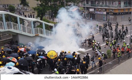 HONG KONG - JULY 27 2019: Hong Kong reporters taking photos of a tear gas thrown to the protesters by the police