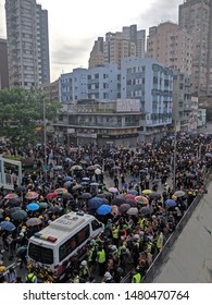 HONG KONG - JULY 27 2019: Protesters surrounded a vandalized police vehicle with umbrella and helmet at Yuen Long during a protest in Hong Kong