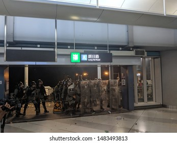 HONG KONG - JULY 27 2019: Riot Police standing ground with full gear at Yuen Long MTR (Metro) station in a protest