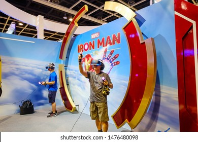 Hong Kong - July 30, 2019: Visitors are seen playing a Marvel Iron man game with a virtual reality VR the 21th ACGHK2019 Ani-Com & Games event in Hong Kong.